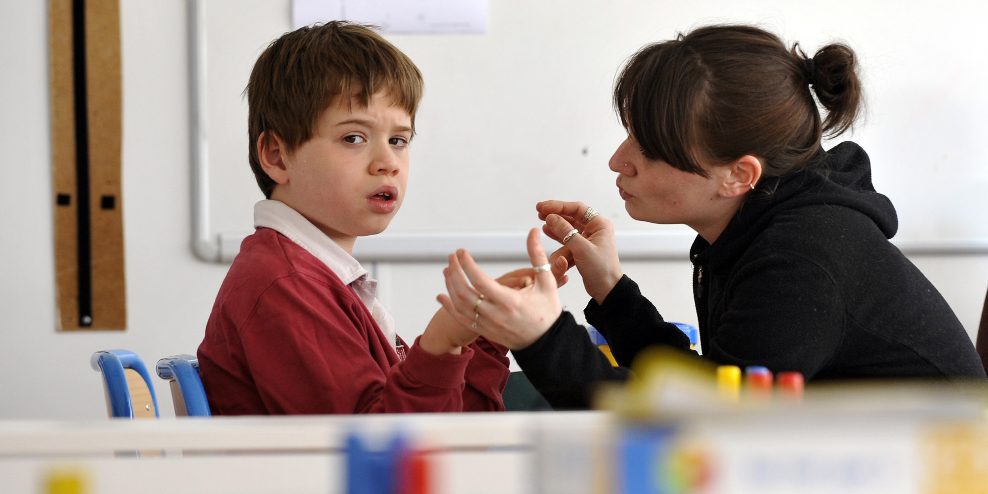"""PARIS - APRIL 24: A teacher deals with an autist child, on April 24, 2008 in Paris at the medical--educational institute """"the small victories"""", school single which uses method ABA"""" Applied Behavior Analysis"""". The future plan on the autism will be presented on May 16, 2008, the national day of autism, and will comprise more new places of reception the precedent, who counted 2,800 of them, according to the declarations of the Solidarity and Minister for Labour Xavier Bertrand, on April 2, 2008, which regretted """"of the years of delay"""" on the matter. (Photo by FRANCK FIFE/AFP/Getty Images)"""